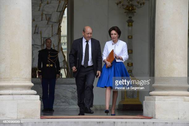 French Defence Minister JeanYves Le Drian and French Social Affairs Minister Marisol Touraine leave the Elysee Palace after the first cabinet meeting...