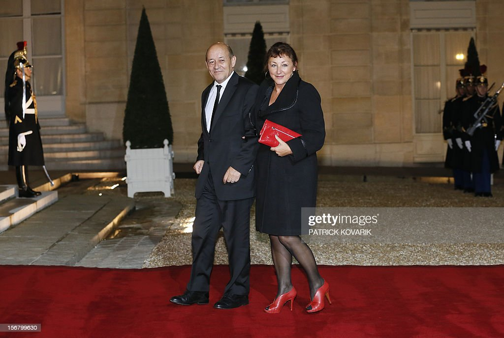 French Defence Minister, Jean-Yves Le Drian and his wife Maria arrive at the Elysee palace in Paris, before a state dinner as part of a two-day state visit of Italian President Giorgio Napolitano, ...