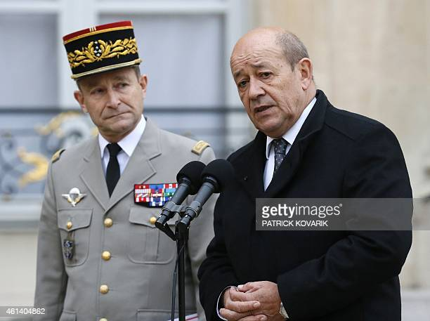 French Defence Minister JeanYves Le Drian flanked by French Army Chief of Staff General Pierre de Villiers speaks to the press at the Elysee Palace...