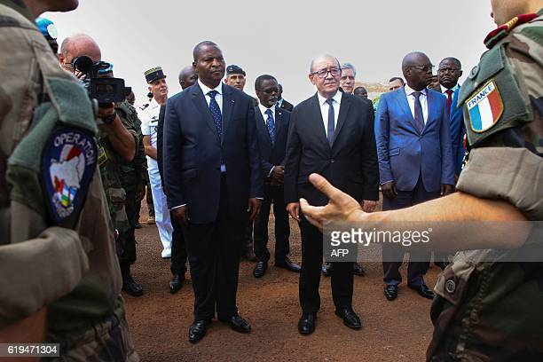 French Defence Minister Jean-Yves Le Drian flanked by President of the Central African Republic Faustin-Archange Touadera , speaks with French...