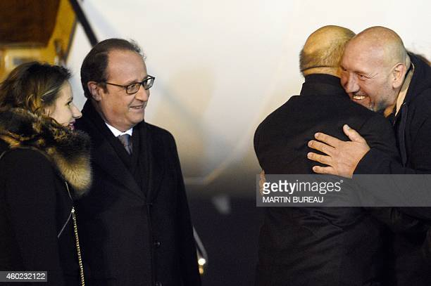 French Defence Minister JeanYves Le Drian greets Serge Lazarevic France's last remaining hostage as French President Francois Hollande and...