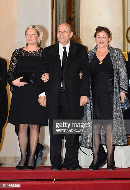 French Defence Minister Jean-Yves Le Drian , his wife Maria Vadillo and Dutch Defence Minister Jeanine Hennis-Plasschaert arrive for a state dinner...