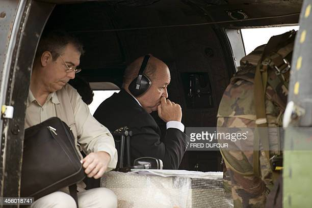 French Defence minister JeanYves Le Drian leaves aboard an helicopter after delivering a speech to French troops of the Sangaris operation at the...