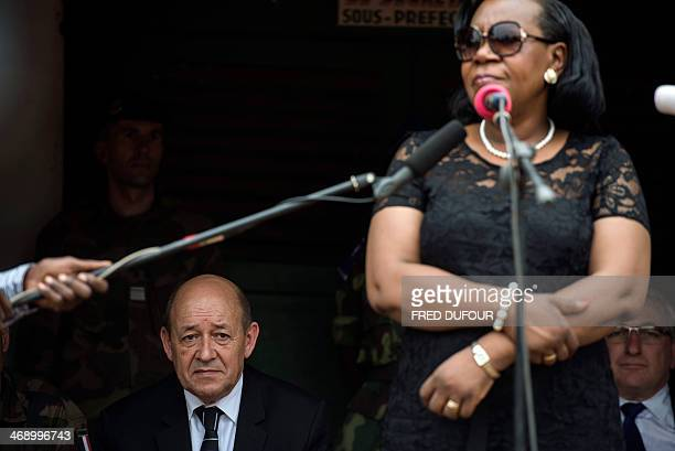 French Defence Minister Jean-Yves Le Drian listens to the speech of new president of Central African Republic, Catherine Samba-Panza in the city of...