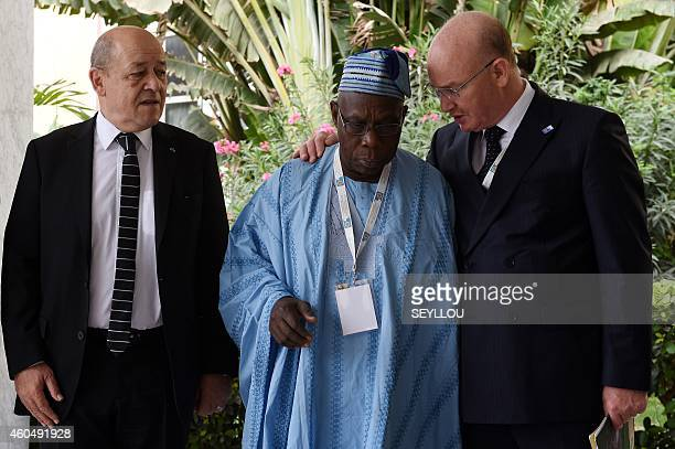 French Defence Minister JeanYves Le Drian looks over former Nigerian president Olusegun Obasanjo speaking with Smail Chergui African Union...