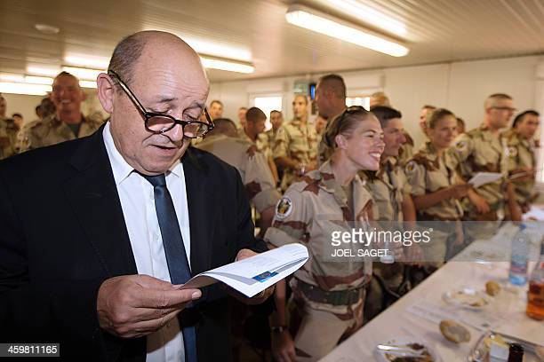 French Defence Minister JeanYves Le Drian sings as he celebrates some hours earlier on December 31 the New Year with French soldiers in Gao His visit...