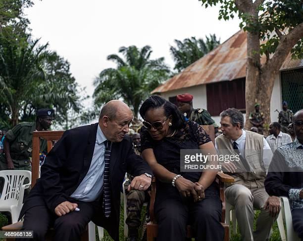 French Defence Minister Jean-Yves Le Drian speaks with new president of Central African Republic, Catherine Samba-Panza during a visit in the city of...