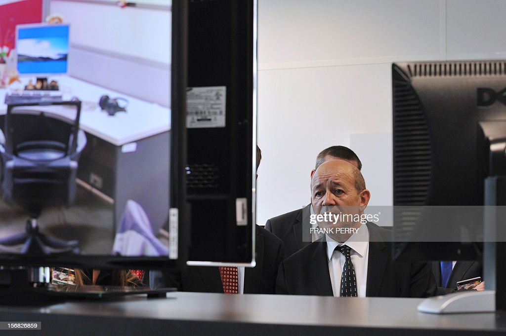 French Defence minister Jean-Yves Le Drian stands during the press conference inaugurating the new Technicolor research and development centre in Cesson-Sevigne near the central western city of Rennes on November 22, 2012.