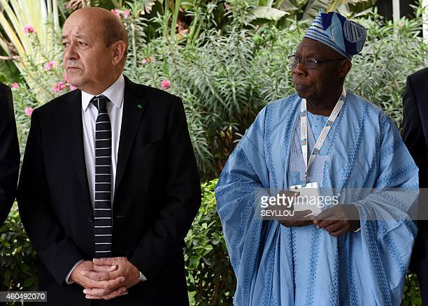 French Defence Minister JeanYves Le Drian stands with former Nigerian president Olusegun Obasanjo during the opening of the first international forum...