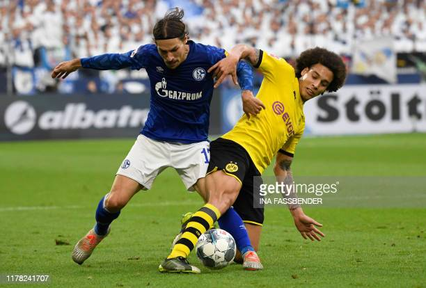French defender Benjamin Stambouli and Dortmund's Belgian midfielder Axel Witsel vie for the ball during the German First division Bundesliga...