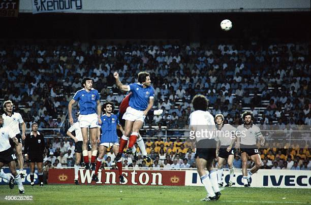 French defender Christian Lopez heads the ball during the 1982 World Cup semifinal football match between West Germany and France on July 8 1982 in...