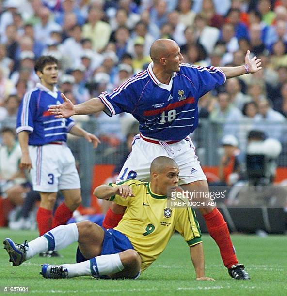 French defender Frank Leboeuf gestures in front of Brazilian striker Ronaldo at Stade de France in SaintDenis north of Paris after the final of the...