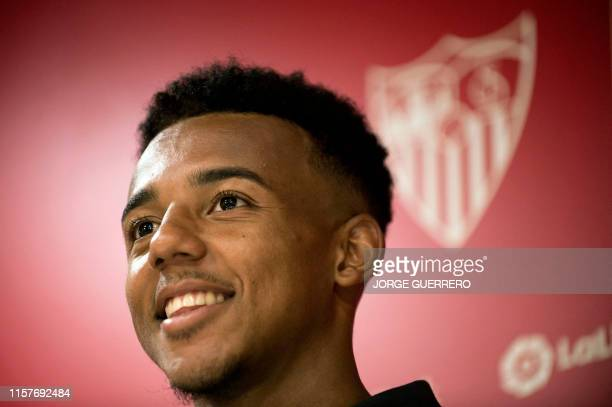 French defender Jules Kounde smiles during his presentation as new player of Sevilla FC at the Ramon Sanchez Pizjuan stadium in Seville on July 26...