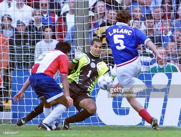 French defender Laurent Blanc scores as Paraguay's goalkeeper Jose Luis Chilavert dives 28 June at the Felix Bollaert stadium in Lens northern France...