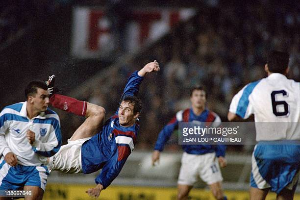 French defender Laurent Blanc tries an acrobatic shot during the World Cup qualifying match France vs Israel the Israel match held on October 13 1993...