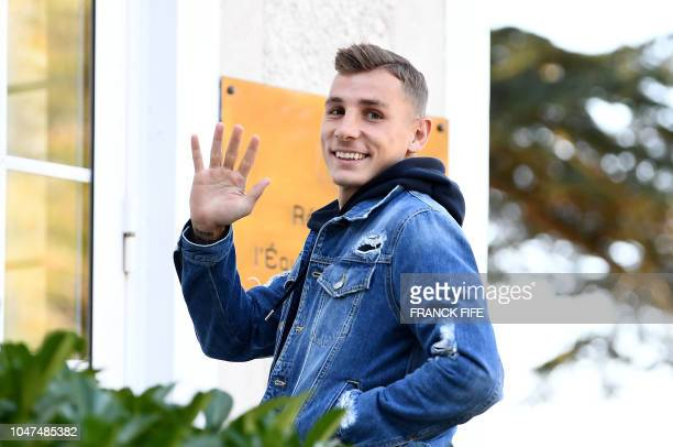 French defender Lucas Digne arrives at France's national football team training base in Clairefontaine en Yvelines on October 8 for the team's...