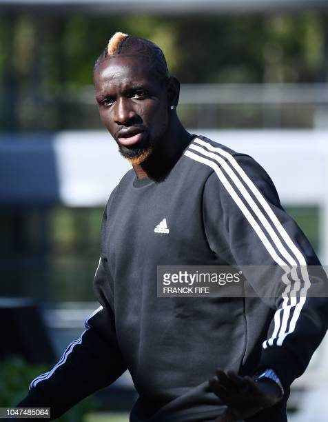French defender Mamadou Sakho arrives at France's national football team training base in Clairefontaine en Yvelines on October 8 for the team's...