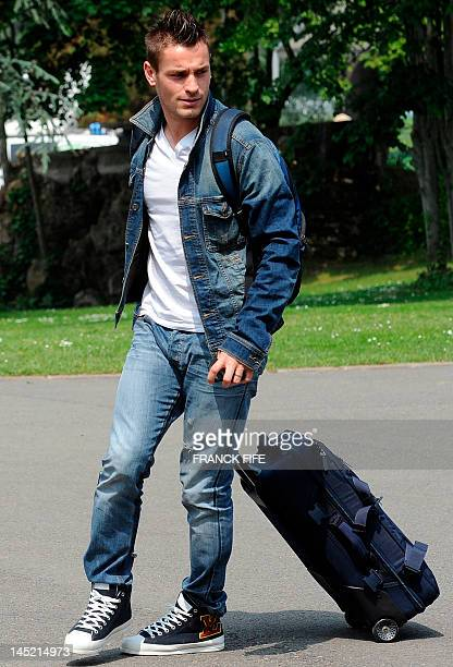 French defender Mathieu Debuchy arrives at the French national football team centre in ClairefontaineenYvelines outside Paris on May 24 for France's...