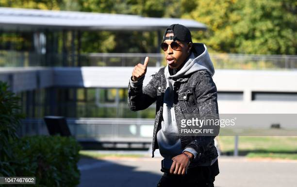 French defender Presnel Kimpembe arrives at France's national football team training base in Clairefontaine en Yvelines on October 8 for the team's...