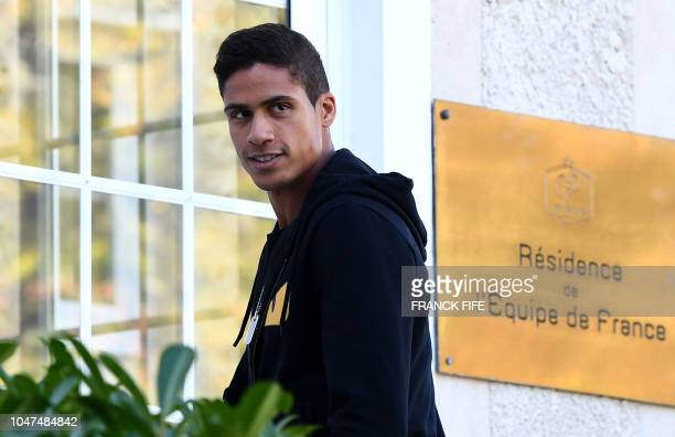 French defender Raphael Varane arrives at France's national football team training base in Clairefontaine en Yvelines on October 8 for the team's...