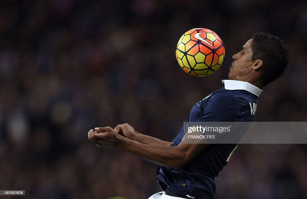 French defender Raphael Varane controls the ball during a friendly international football match between France and Germany ahead of the Euro 2016, on November 13, 2015 at the Stade de France stadium in Saint-Denis, north of Paris. AFP PHOTO / FRANCK FIFE