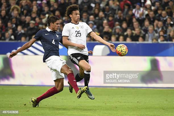 French defender Raphael Varane vies with Germany's midfielder Leroy Sane during a friendly international football match between France and Germany...