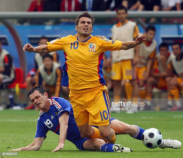 French defender Willy Sagnol fights for the ball with Romanian forward Adrian Mutu during their Euro 2008 Championships Group C football match France...