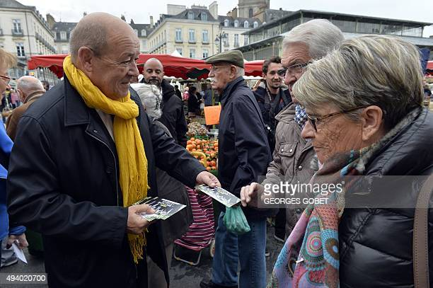 French Defense Minister and Socialist Party candidate for the upcoming regional elections in Bretagne JeanYves Le Drian distributes leaflets at the...