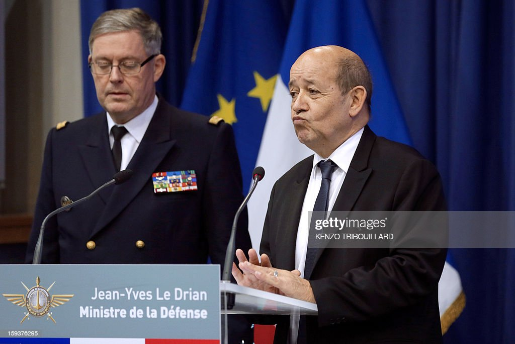 French Defense Minister Jean-Yves Le Drian (R), flanked by French army chief of staff, Admiral Edouard Guillaud, gestures during a press conference on January 12, 2013 in Paris. Le Drian said that a French pilot was killed on January 11 during a helicopter raid to prevent Islamist groups controlling northern Mali from advancing toward the capital Bamako. The raid was carried out to support Mali ground troops in the battle for the key town of Kona. Backed by French air power, Malian troops on January 11 unleashed an offensive against Islamist rebels who, having seized control of the north of the country in March last year, were threatening to push south.