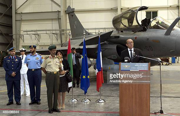 French Defense Minister JeanYves Le Drian makes his speech upon his visit to Al Dhafra Air Base as United Arab Emirates' Chief of Staff General Hamad...