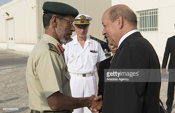 French Defense Minister JeanYves Le Drian shakes hand with United Arab Emirates' Chief of Staff General Hamad Mohammed Thani alRumaithi upon his...