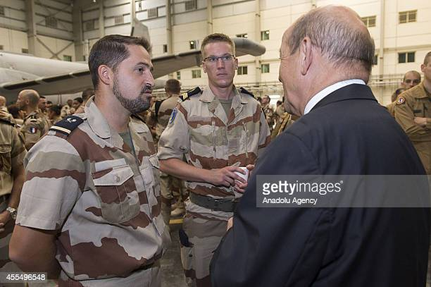 French Defense Minister JeanYves Le Drian talks with soldiers upon his visit to Al Dhafra Air Base in Abu Dhabi United Arab Emirates on September 15...