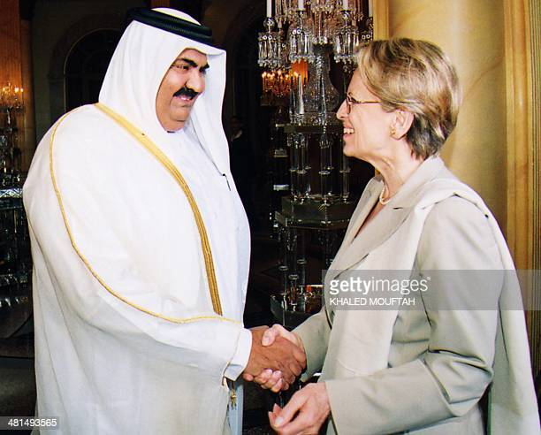 French Defense Minister Michele Alliot Marie is greated by the Emir of Qatar Hamad bin Khalifa alThani in Doha 22 April 2004 Marie is on a tour of...