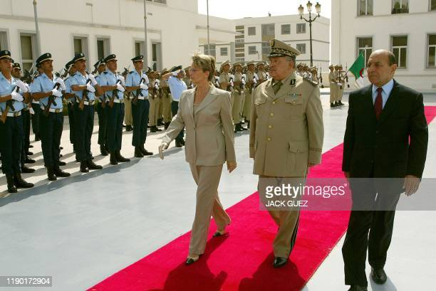 French Defense Minister Michèle AlliotMarie reviews the Algerian honor guard with Algerian General Gaid Salah and Algerian Interior Minister Yazid...