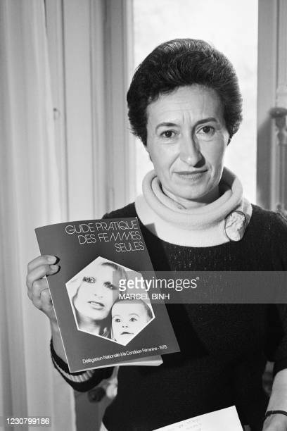 """French delegate on the status of women Jacqueline Nonon presents a practical guide on """"single mothers"""" on March 9, 1978 in Paris."""