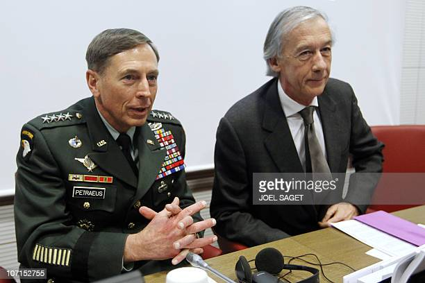 French deputy Axel Poniatowski also head of France's National Assembly Foreign Affairs committee and US war commander General David Petraeus take...
