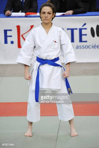 French deputy minister for Ecology and former Karatekata French champion Chantal Jouanno gets ready to compete with her team in the French Karate...