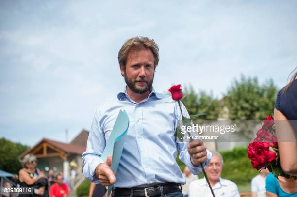 French deputy of Landes and spokesman for the Group Nouvelle Gauche Boris Vallaud holds a rose during the 45th annual meeting of the French socialist...