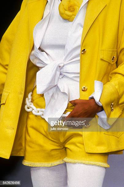 French design house Chanel displays its women's line at the 1992 SpringSummer fashion show in Paris The model is wearing a yellow coat and cutoff...