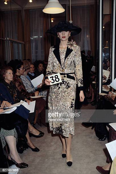 French design house Chanel shows its 1979 springsummer women's haute couture collection in Paris The model is wearing a patterned suit and a large...
