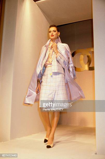 French design house Chanel shows its 1982 SpringSummer women's readytowear line in Paris Model Ines de la Fressange is wearing a white checked suit...