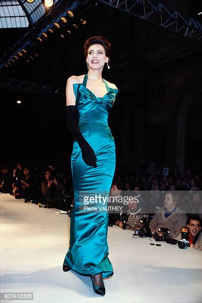 French design house Chanel shows its 1986 springsummer women's haute couture line in Paris Model Ines de la Fressange is wearing a long satin evening...