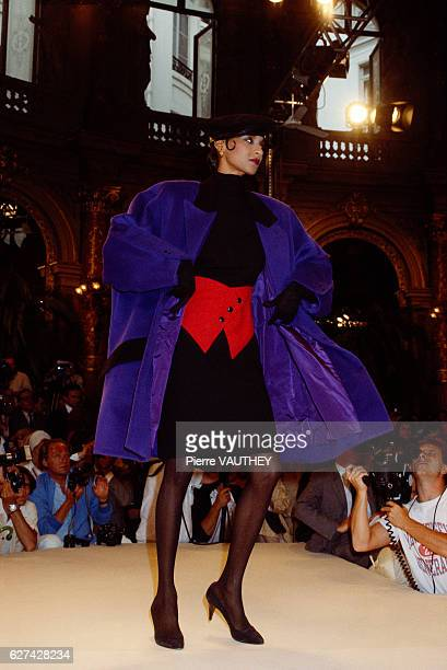 French design house Christian Dior shows its 1985-1986 fall-winter women's haute couture line in Paris. The model is wearing a deep purple coat over...