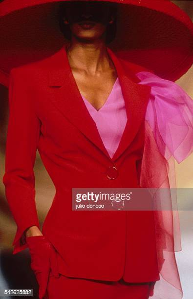 French design house Christian Dior shows its 1991 women's springsummer haute couture line The model is wearing a bright red suit with a large...