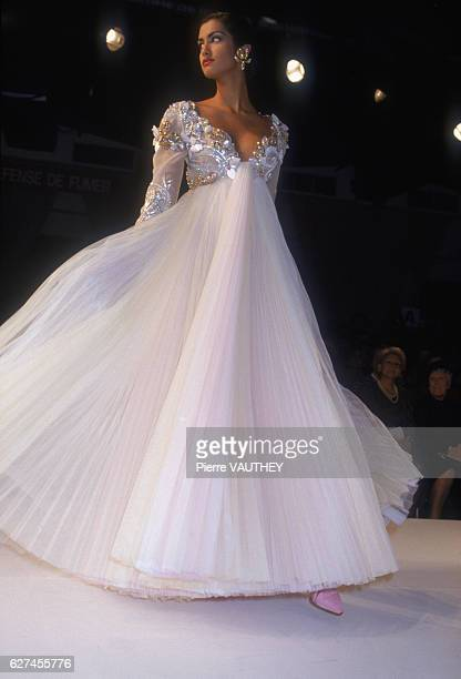 French design house Christian Dior shows its women's 1991 springsummer haute couture line in Paris Model Yasmeen Ghauri is wearing an evening gown...