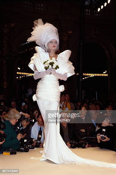 French design house Emanuel Ungaro shows its 1986 springsummer women's haute couture line in Paris The model is wearing a wedding dress with...