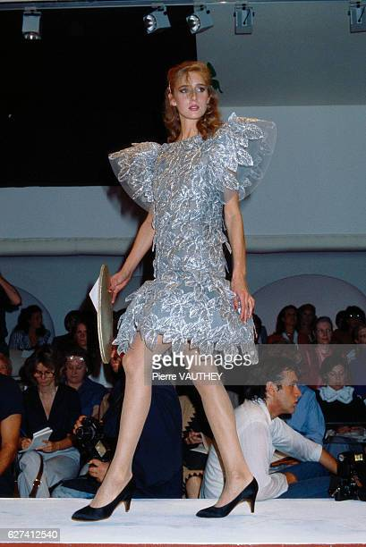 French design house Patou show its 1982 SpringSummer women's haute couture line in Paris The model is wearing a silver and light blue dress with...