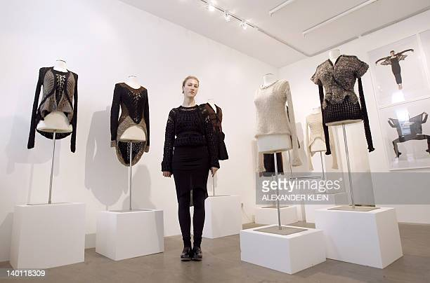 French designer Alice Lemoine poses next to her creations for Le Moine Tricote a Paris during the presentation of her Fall/Winter 20122013...