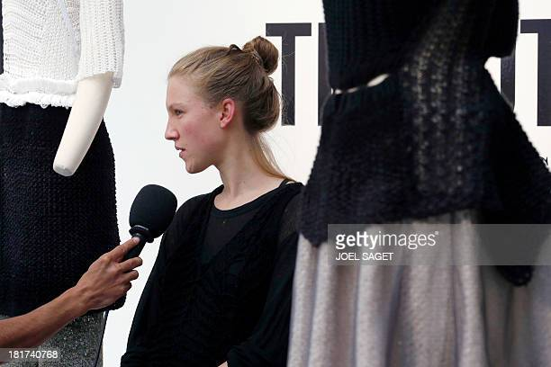 French designer Alice Lemoine speaks to journalists as her creations are on display during the 2014 Spring/Summer readytowear collection fashion...