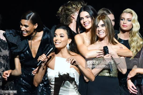 TOPSHOT French designer and fashion editor Carine Roitfeld and US actress Eva Longoria conduct a auction on stage on May 23 2019 with French model...